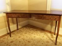 Crescent front writing desk